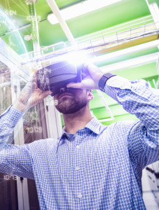 Man using virtual reality headset in industrial environment