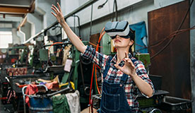 Staff using virtual reality headset for training in industrial factory
