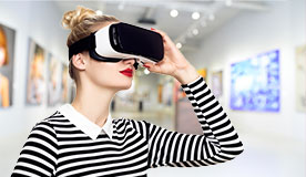 Woman using virtual reality headset in museum